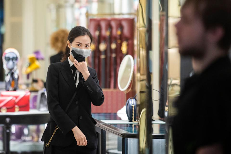 Shop assistants in luxury outlets in Sydney's CBD are seen wearing masks on January 31, 2020 in Sydney, Australia. (Photo by Jenny Evans/Getty Images)