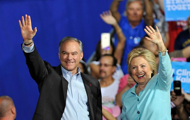 US Democratic presidential candidate Hillary Clinton and running mate Tim Kaine greet supporters at a campaign rally in Miami on July 23, 2016 (AFP Photo/Gaston De Cardenas)