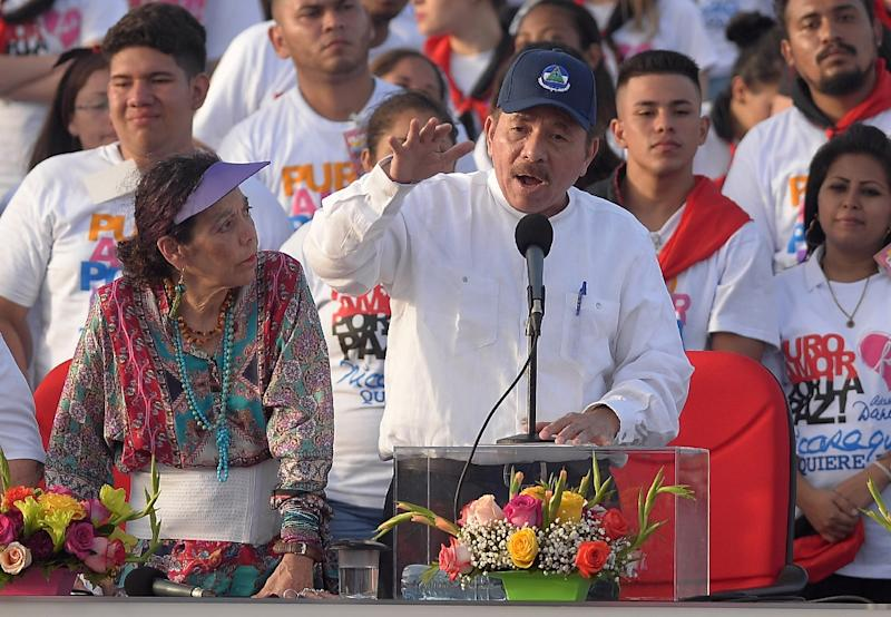 Nicaraguan President Daniel Ortega, right, is blaming the United States for violence in his country