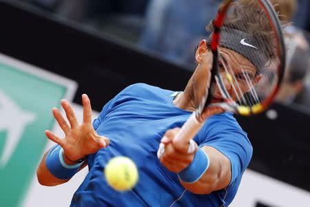 Nadal of Spain hits a return to Djokovic of Serbia during their men's singles final match at the Rome Masters tennis tournament