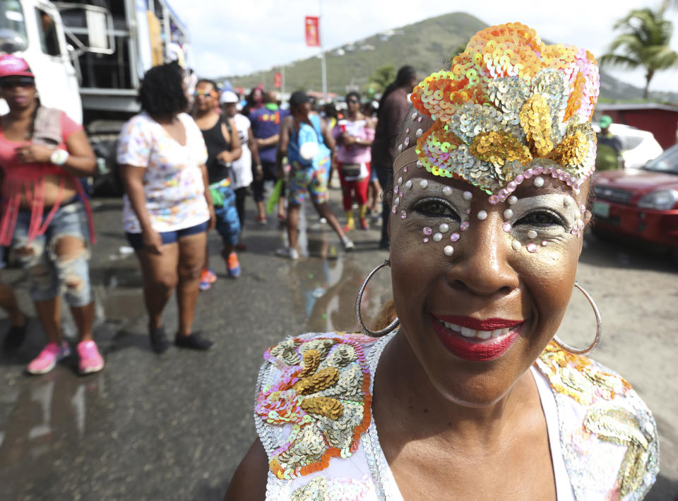 PHILIPSBURG, SINT MAARTEN: A masquerader dances behind music trucks during the j'ouvert street parade as part of the 47th annual Carnival in St Maarten on April 27, 2016 in Philipsburg, St Maarten.  (Photo by Sean Drakes/LatinContent via Getty Images)