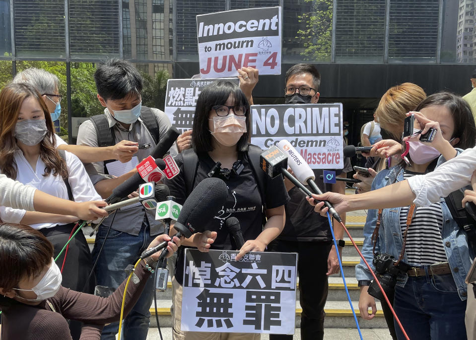 Hong Kong Alliance in Support of Patriotic Democratic Movements of China Vice Chairperson Chow Hang-tung speaks to media outside a court in Hong Kong, Thursday, May 6, 2021. High-profile Hong Kong activist Joshua Wong will face an additional 10 months in jail for participating in an unauthorized Tiananmen vigil held last year to commemorate the 1989 crackdown on protesters in Beijing, as Hong Kong authorities continue tightening control over dissent in the city. (AP Photo/Rafael Wober)