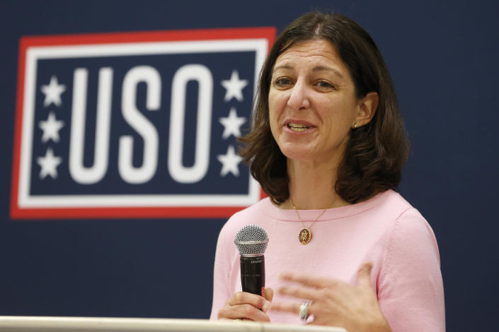 FILE - In this Oct. 4, 2019, file photo Rep. Elaine Luria, D-Va., speaks to participants in a USO Pathfinder program in Virginia Beach, Va. Luria has built a reputation as pro-military and proud moderate in one of the nation's most Navy- and Defense Department-dependent swing districts. But she's also agreed to join a House committee investigating the deadly Jan. 6 insurrection at the U.S. Capitol, which could raise uncomfortable questions about links between the military and extremist groups and test her centrist credentials. (AP Photo/Steve Helber, File)