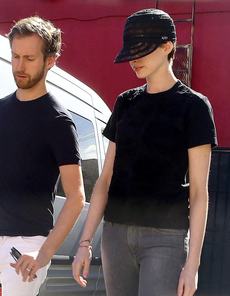 This quirky mesh headwear is a favorite of Oscar nominee Anne Hathaway. The actress wore the black hat three days in a row. On Monday, she paired it with her workout outfit and jacket. Over the weekend, she combined it with jeans and a little black t-shirt. She can make the most of even this hat, but let's hope she leaves it at home when she hits the red carpet.
