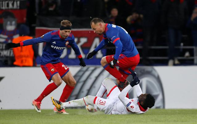 Soccer Football - Europa League Round of 32 Second Leg - CSKA Moscow vs Red Star Belgrade - VEB Arena, Moscow, Russia - February 21, 2018 CSKA Moscow's Sergei Ignashevich and Vasili Berezutski in action with Red Star Belgrade's El Fardou Ben Nabouhane REUTERS/Maxim Shemetov