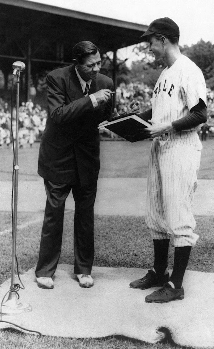 "<p>George Bush, right, receives the manuscript of ""The Babe Ruth Story"" from Ruth during a ceremony on Yale's baseball field in West Haven, Conn., in 1948. (Photo: AP) </p>"