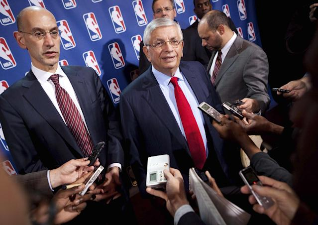 FILE - In this Nov. 10, 2011, file photo, NBA Commissioner David Stern, center, speaks to the news media alongside Deputy commissioner Adam Silver after a marathon meeting with the Players Association in New York. He is not in the Hall of Fame, he never played in an All-Star game and he is about a foot shorter than most NBA stars. But try to find an NBA legacy more lasting than Stern's, who is retiring Saturday, Feb. 1, 2014 after exactly 30 years on the job. Silver will be the head of the league. (AP Photo/John Minchillo, File)
