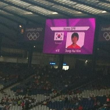 "This mobile phone photo provided by James Crossan, shows a  mistakenly displayed South Korean flag on a jumbo screen instead of North Korea's, before a women's soccer match which prompted the North Koreans to refuse to take the field for nearly an hour on Wednesday, July 25, 2012, in Glasgow, Scotland. ""We will apologize to the team and the National Olympic Committee and steps will be taken to ensure this does not happen again,"" organizers said. (AP Photo/James Crossan)"