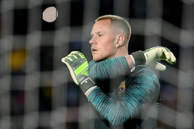 Goalkeeper Marc-Andre Ter Stegen has been undergoing treatment over the winter break but will mis Barcelona's derby on Saturday (AFP Photo/Josep LAGO)