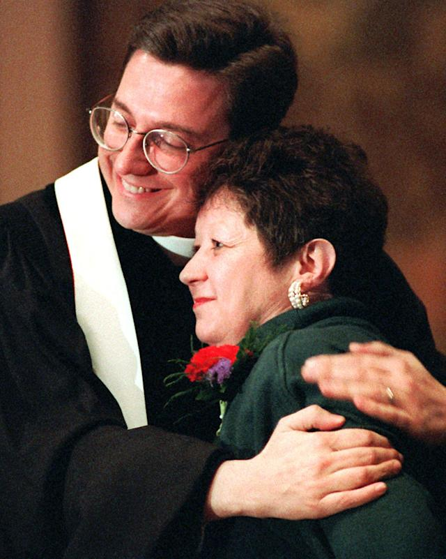 FILE - In this Sunday, Jan. 21, 1996 file photo, Norma McCorvey, Jane Roe in the 1973 Roe v. Wade decision, is embraced by The Rev. Robert L. Schenck of the National Clergy Council before she addresses a memorial service at Georgetown University in Washington. McCorvey, in town to join abortion opponents for their annual protest march, shocked abortion advocates in 1995 by announcing that she now opposes the procedure. (AP Photo/Cameron Craig, File)
