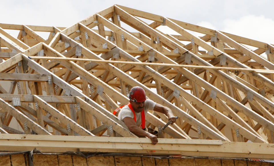 A construction worker swings his hammer at a new home development in Ottawa July 9, 2008. The number of housing starts dropped in June but the previous month's figure was upwardly revised, which convinced economists the sector is not headed for a U.S.-style meltdown.       REUTERS/Chris Wattie       (CANADA)