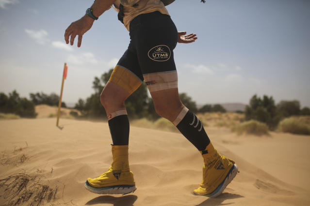 A competitor crosses sand dunes as he takes part in stage 4 of the 33rd edition of Marathon des Sables, in the Sahara desert, near Merzouga, southern Morocco, Friday, April 13, 2018. (AP Photo/Mosa'ab Elshamy)