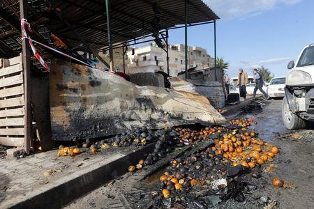 A damaged fruit shop is seen at the site of twin car bombs in Benghazi, Libya, January 24, 2018. REUTERS/Esam Omran Al-Fetori