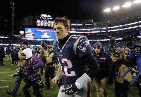Jan 13, 2018; Foxborough, MA, USA; New England Patriots quarterback Tom Brady (12) runs off the field after defeating the Tennessee Titans in the AFC Divisional playoff game at Gillette Stadium. Mandatory Credit: David Butler II-USA TODAY Sports