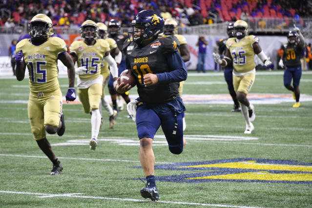 North Carolina A&T quarterback Kylil Carter is pursued by Alcorn State players during the second half of the Celebration Bowl NCAA college football game, Saturday, Dec. 21, 2019, in Atlanta. North Carolina A&T won 64-44. (John Amis/Atlanta Journal-Constitution via AP)