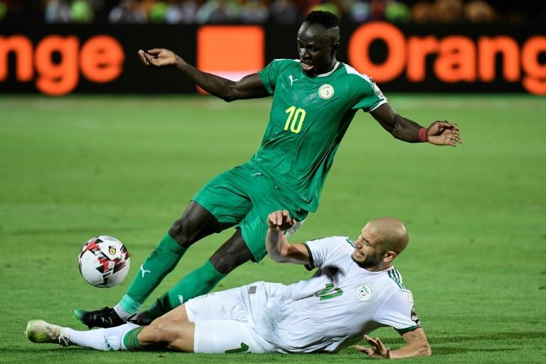 Senegal star Sadio Mane (L) scored the winner against Guinea-Bissau Sunday to clinch qualification for the 2021 Africa Cup of Nations.