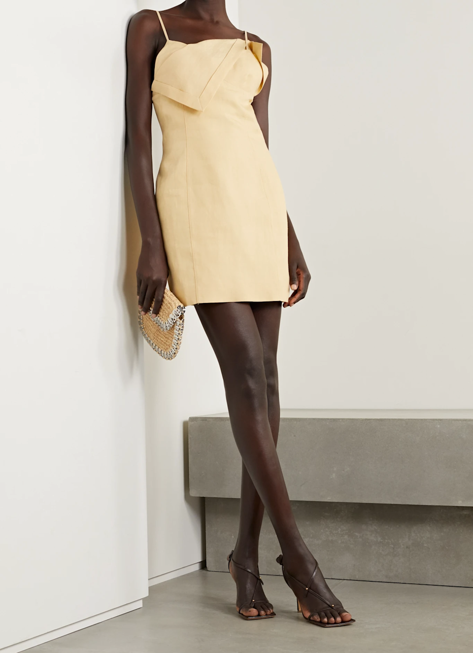 """At this point, we're convinced that everything Jacquemus creates is perfection, including but not limited to this cream linen mini. $625, Net-a-Porter. <a href=""""https://www.net-a-porter.com/en-us/shop/product/jacquemus/clothing/mini-dresses/open-back-draped-linen-mini-dress/23471478575812302"""" rel=""""nofollow noopener"""" target=""""_blank"""" data-ylk=""""slk:Get it now!"""" class=""""link rapid-noclick-resp"""">Get it now!</a>"""