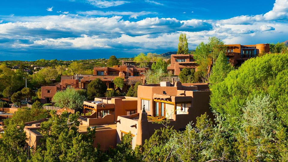 Hillside houses and trees in Santa Fe, New Mexico