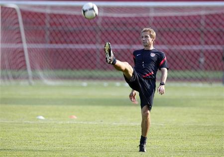 U.S. head coach Klinsmann kicks the ball during a practice session in San Pedro Sula