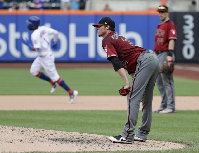 Arizona Diamondbacks starting pitcher Clay Buchholz reacts as New York Mets' Amed Rosario runs the bases after hitting a home run during the sixth inning of a baseball game Sunday, May 20, 2018, in New York. (AP Photo/Frank Franklin II)