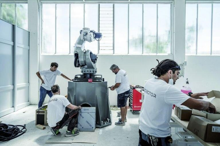 Technicians assemble a robot at the Robotor company in Carrara, Italy on June 30, 2021. Using the same marble found in Renaissance masterpieces, a team of robots is accepting commissions. Their owners say tech is essential to Italy√¢ˇÊ¨'Ñ¢s artistic future. (Alessandro Grassani/The New York Times)