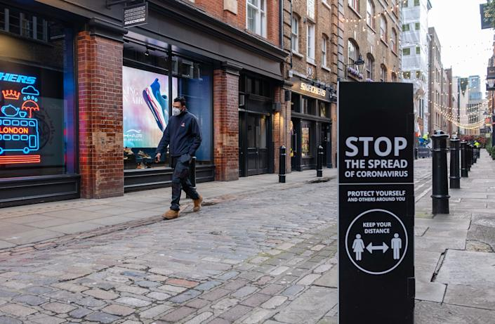 A man walk past closed shops and COVID-19 social distancing sign at Covent Garden, a shopping and entertainment hub in west end London. UK has confirmed 38000 new cases and 599 COVID-19 deaths. (Photo by May James / SOPA Images/Sipa USA)