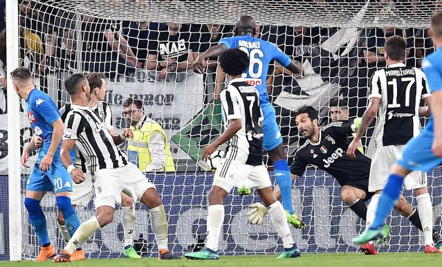 Napoli's Kalidou Koulibaly, top center, scores during a Serie A soccer match between Juventus and Napoli at the Allianz Stadium in Turin, Italy, Sunday, April 22, 2018. (Alessandro Di Marco/ANSA via AP)