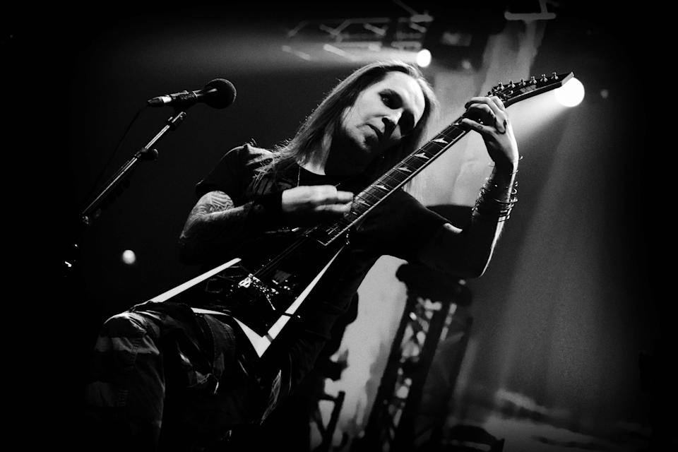 "A picture taken on March, 22, 2011 shows Finnish singer and guitarist Alexi Laiho of the Finnish black metal band ""Children of Bodom"", as he performs during the Helsinki leg of their ""The Ugly World Tour 2011."""