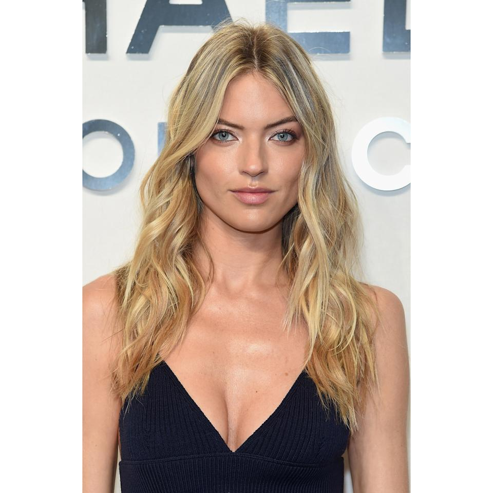 """<p>For a simple, versatile option, try Martha Hunt's long, haphazard layers. """"I take the bottom two inches of hair and cut them in a way that's not too perfect by pointing the scissors downward,"""" says hairstylist Renato Campora. The slightly imperfect ends make this a wash-and-go kind of cut. """"You can blow it out or let it air-dry — the cut takes care of the styling for you."""" This cut complements every face shape and can be styled with a middle or side part.</p>"""