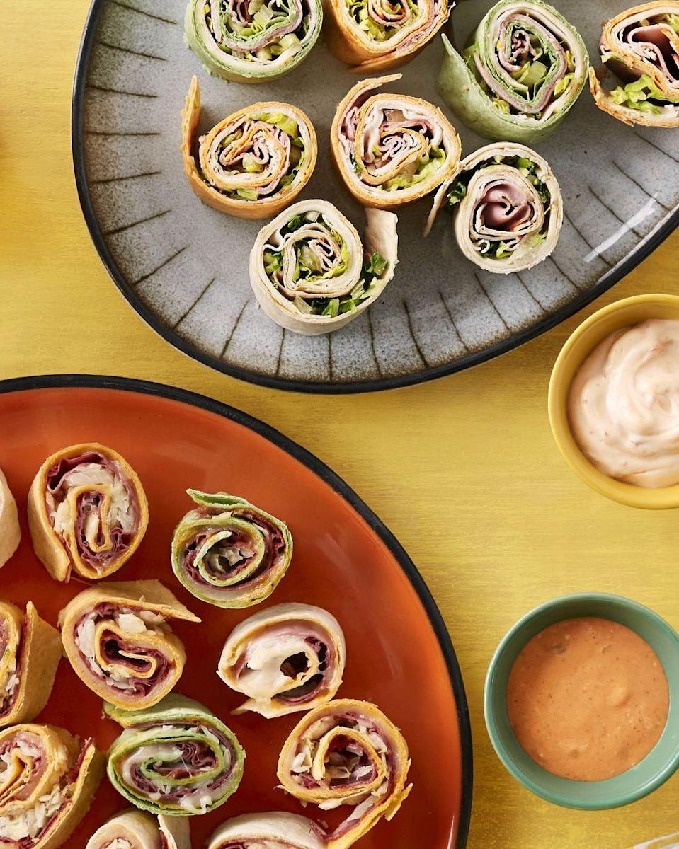 """<p>Prep these cute rollups in the morning and serve later. Your kids will love them—and so will you!</p><p><strong><a href=""""https://www.thepioneerwoman.com/food-cooking/recipes/a34239402/make-ahead-sandwich-rolls/"""" rel=""""nofollow noopener"""" target=""""_blank"""" data-ylk=""""slk:Get the recipe."""" class=""""link rapid-noclick-resp"""">Get the recipe.</a></strong></p><p><strong><a class=""""link rapid-noclick-resp"""" href=""""https://go.redirectingat.com?id=74968X1596630&url=https%3A%2F%2Fwww.walmart.com%2Fbrowse%2Fhome%2Fserveware%2Fthe-pioneer-woman%2F4044_623679_639999_2347672%2FYnJhbmQ6VGhlIFBpb25lZXIgV29tYW4ie&sref=https%3A%2F%2Fwww.thepioneerwoman.com%2Ffood-cooking%2Fmeals-menus%2Fg35049189%2Fsuper-bowl-food-recipes%2F"""" rel=""""nofollow noopener"""" target=""""_blank"""" data-ylk=""""slk:SHOP SERVEWARE"""">SHOP SERVEWARE</a><br></strong></p>"""