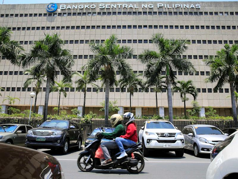 FILE PHOTO: A motorcycle pases a building of the Bangko Sentral ng Pilipinas (Central Bank of the Philippines) in Manila, Philippines April 28, 2016. REUTERS/Romeo Ranoco