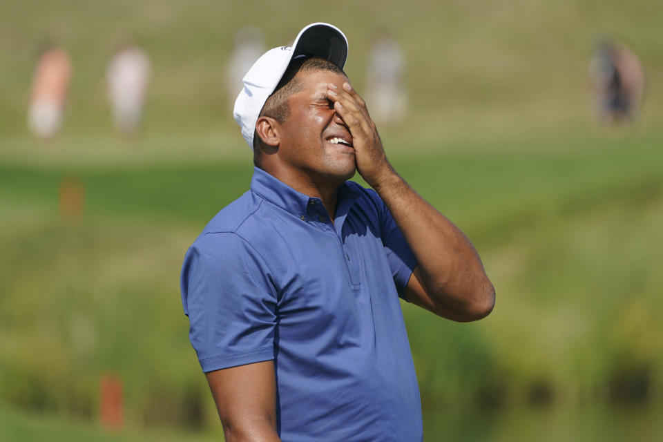Jhonattan Vegas reacts after missing a putt on the 16th hole during the final round of the 3M Open golf tournament in Blaine, Minn., Sunday, July 25, 2021. (AP Photo/Craig Lassig)