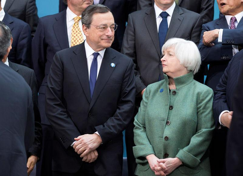 FILE PHOTO:Draghi and Yellen speak before the G20 finance ministers and central bankers family portrait during the IMF/World Bank 2014 Spring Meeting in Washington