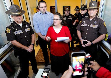 FILE PHOTO: Kim Davis, the Kentucky county clerk who refused to issue same-sex marriage licenses, addresses the media just before the doors are opened to the Rowan County Clerk's Office in Morehead, Kentucky, U.S. on September 14, 2015.   REUTERS/Chris Tilley/File Photo