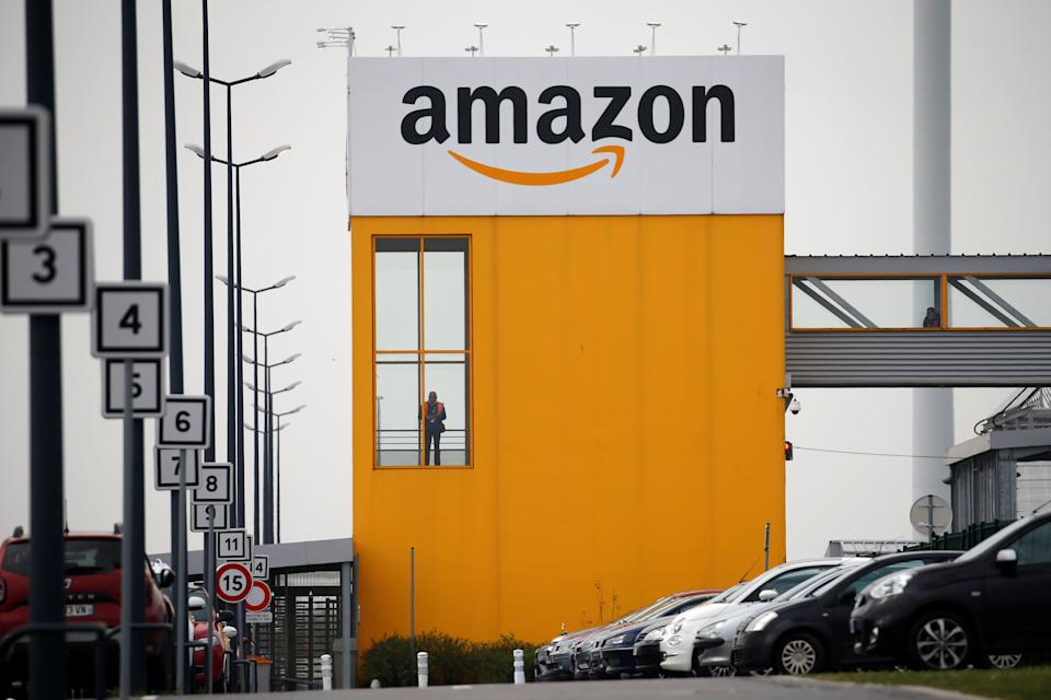 The logo of Amazon is seen at the company logistics center in Lauwin-Planque, northern France, March 19, 2020. Several hundred employees protested in France, calling on the U.S. e-commerce giant to halt operations or make it easier for employees to stay away during the coronavirus (COVID-19) epidemic. REUTERS/Pascal Rossignol