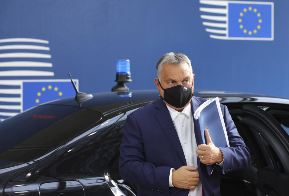 FILE - In this Oct. 15, 2020, file photo, Hungary's Prime Minister Viktor Orban arrives for an EU summit at the European Council building in Brussels. The European Union still hasn't completely sorted out its messy post-divorce relationship with Britain — but it has already been plunged into another major crisis. This time the 27-member union is being tested as Poland and Hungary block passage of its budget for the next seven years and an ambitious package aimed at rescuing economies ravaged by the coronavirus pandemic. (AP Photo/Olivier Matthys, Pool, File)