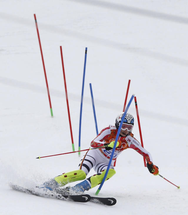 Germany's Maria Hoefl-Riesch skis past the gates during the slalom portion of the women's supercombined at the Sochi 2014 Winter Olympics, Monday, Feb. 10, 2014, in Krasnaya Polyana, Russia. (AP Photo/Christophe Ena)
