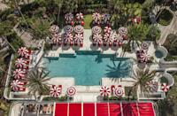 """<p>What do you get when you bring in acclaimed director Baz Luhrmann and his partner in life and costume design, Catherine Martin, to design a luxury hotel in Miami? A one-of-a-kind, retro-chic property with an abundance of theatrical details. Just like Luhrmann's movies and Martin's costumes, <a href=""""https://www.faena.com/miami-beach"""" rel=""""nofollow noopener"""" target=""""_blank"""" data-ylk=""""slk:Faena Hotel Miami Beach"""" class=""""link rapid-noclick-resp"""">Faena Hotel Miami Beach</a> is larger-than-life, full of color, and utterly unforgettable. Plus, each floor features luxe amenities, like 24-hour butler service, a 22,000-square-foot spa, and two of the city's hottest restaurants. </p>"""