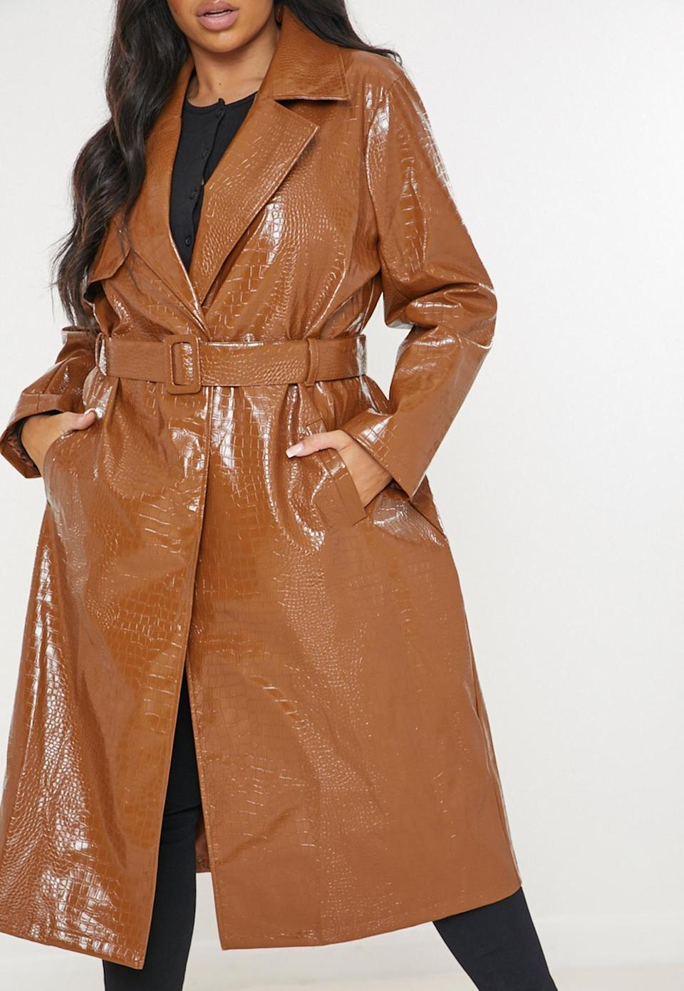 """<br><br><strong>Missguided</strong> Plus Size Brown Croc Faux Leather Trench Coat, $, available at <a href=""""https://www.missguided.co.uk/plus-size-brown-croc-faux-leather-trench-coat-10209484"""" rel=""""nofollow noopener"""" target=""""_blank"""" data-ylk=""""slk:Missguided"""" class=""""link rapid-noclick-resp"""">Missguided</a>"""