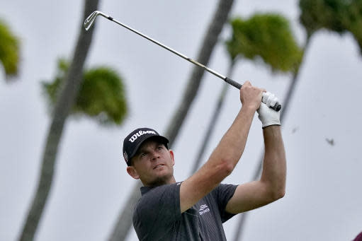 Brendan Steele hits from the 17th tee during the third round of the Sony Open PGA Tour golf event, Saturday, Jan. 11, 2020, at Waialae Country Club in Honolulu. (AP Photo/Matt York)
