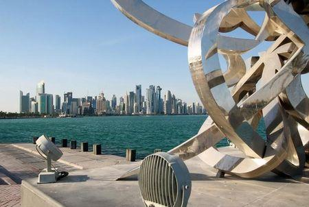 FILE PHOTO: Buildings are seen from across the water in Doha