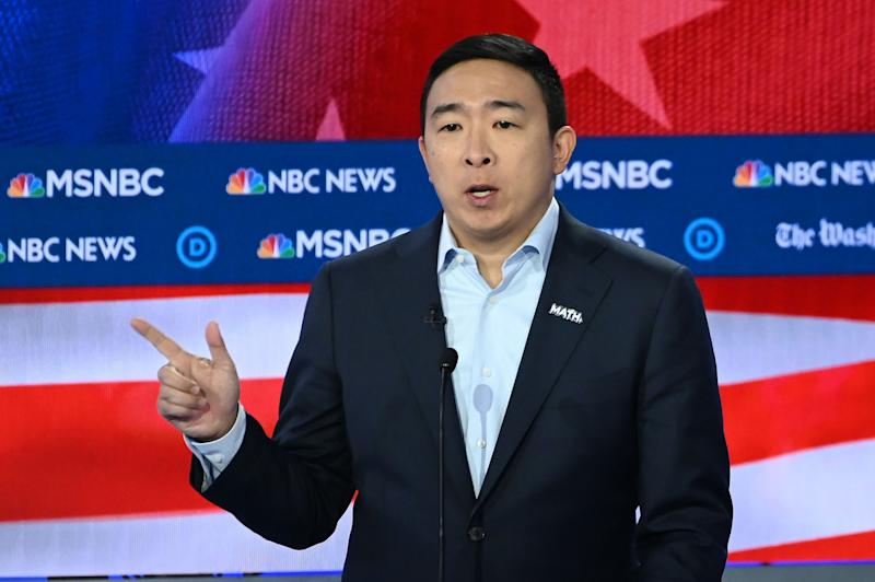 Democratic presidential candidate former technology executive Andrew Yang walks onto the stage before the Democratic presidential primary debate in Atlanta.