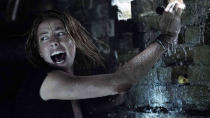 """The formula for Alexandre Aja's latest is simple. Kaya Scodelario in a flooded crawl space, with alligators. What follows is a tense and thrilling fight for survival that <a href=""""https://uk.movies.yahoo.com/quentin-tarantino-favourite-film-2019-161054214.html"""" data-ylk=""""slk:Quentin Tarantino has crowned his movie of the year;outcm:mb_qualified_link;_E:mb_qualified_link;ct:story;"""" class=""""link rapid-noclick-resp yahoo-link"""">Quentin Tarantino has crowned his movie of the year</a>. It has the feel of an old school midnight movie, dealing in over-cranked gore and enjoyably ripe dialogue. (Credit: Paramount)"""