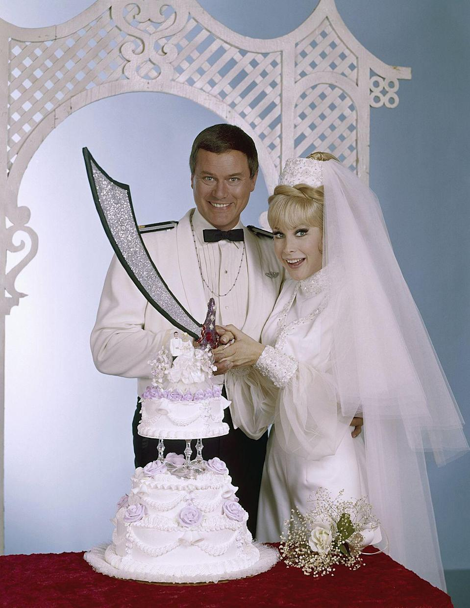 <p>Jeannie didn't wear her classic pink cropped top and harem pants when she wed <del>Master</del> Major Nelson in <em>I Dream of Jeannie. </em>Instead, she opted for a 'Jeannie inspired' white suit dress with tulle sleeves and, don't worry, her signature pony-tail. </p>