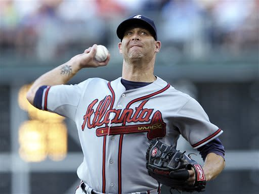 Atlanta Braves' Tim Hudson throws a pitch in the first inning of a baseball game against the Philadelphia Phillies on Saturday, July 6, 2013, in Philadelphia. (AP Photo/Michael Perez)
