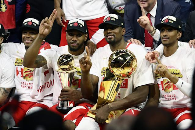 Kawhi Leonard #2 and Serge Ibaka #9 of the Toronto Raptors celebrates their teams victory over the Golden State Warriors in Game Six to win the 2019 NBA Finals at ORACLE Arena on June 13, 2019 in Oakland, California. (Photo by Ezra Shaw/Getty Images)