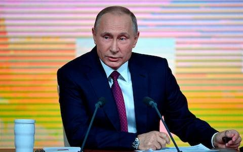 Russian President Vladimir Putin speaks during his annual press conference in Moscow - Credit: ALEXANDER NEMENOV/AFP