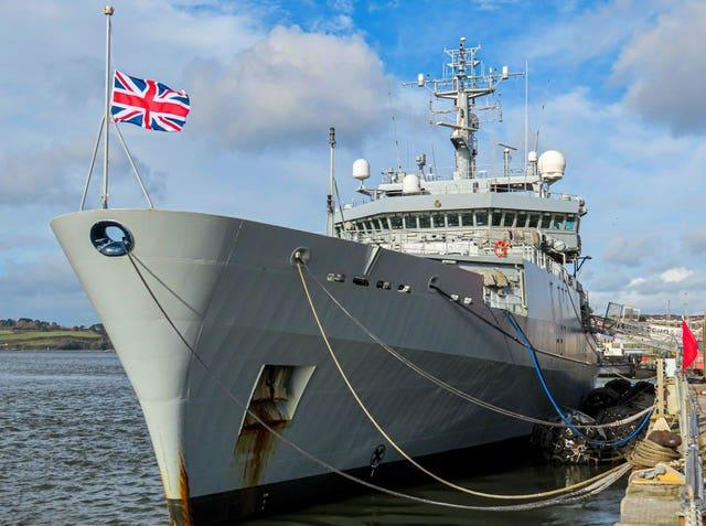 HMS Echo in Devonport Dockyard flying its flag at half mast in tribute to Captain Sir Tom Moore