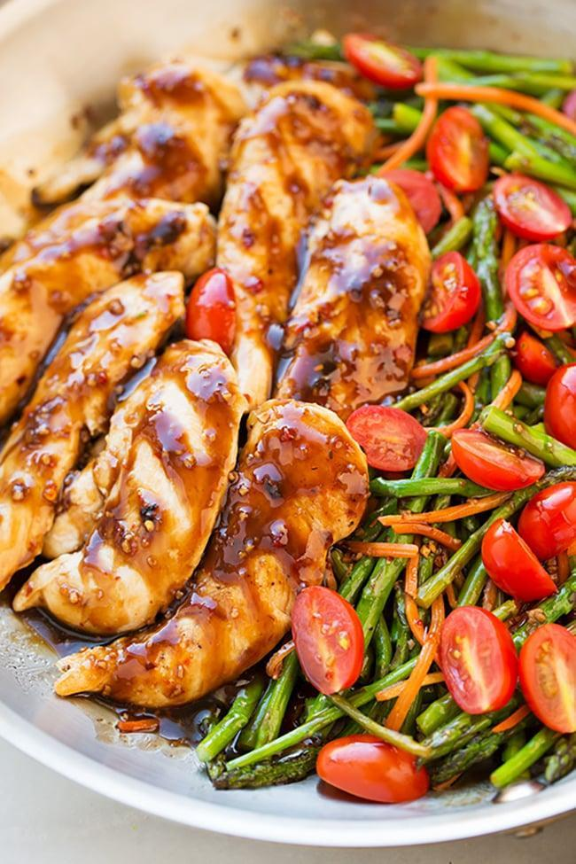 """<p>This one-pan dish combines chicken, asparagus, tomatoes, and carrots with a dreamy balsamic dressing for <a href=""""https://www.popsugar.com/family/Low-Carb-Family-Meals-46017231"""" class=""""link rapid-noclick-resp"""" rel=""""nofollow noopener"""" target=""""_blank"""" data-ylk=""""slk:a low-carb dinner that can feed a whole family"""">a low-carb dinner that can feed a whole family</a>.</p> <p><strong>Get the recipe:</strong> <a href=""""https://www.cookingclassy.com/one-pan-balsamic-chicken-veggies/"""" class=""""link rapid-noclick-resp"""" rel=""""nofollow noopener"""" target=""""_blank"""" data-ylk=""""slk:one-pan balsamic chicken and veggies"""">one-pan balsamic chicken and veggies</a></p>"""