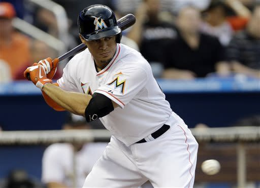 Miami Marlins batter Giancario Stanton eyes the ball before hitting a single-run home run during the first inning of a baseball game against the Chicago Cubs in Miami, Saturday, April 27, 2013. (AP Photo/J Pat Carter)